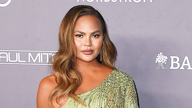 Chrissy Teigen Reveals She Still Has A 'Bump' While Rocking Cutout Dress 2 Mos. After Losing Baby