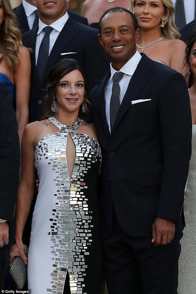 Woods and his girlfriend Erica Herman (pictured together), the general manager of the restaurant at the time, were initially named in the suit but were dropped a few months later