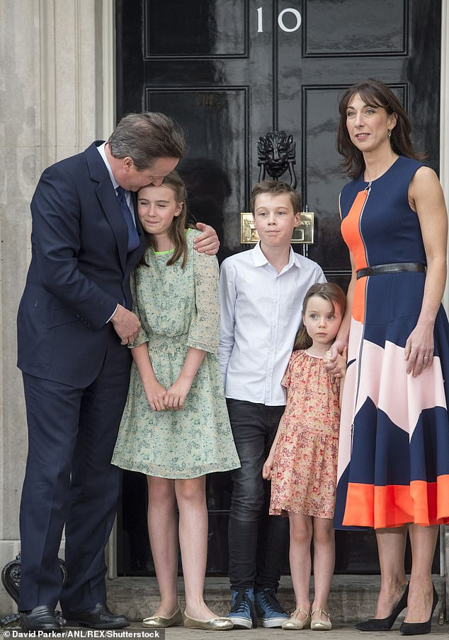 A kiss farewell: David Cameron, wife Samantha and their children leave Downing Street in July 2016, after he resigned as Prime Minister