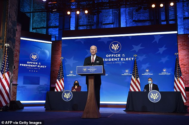 President-elect Joe Biden (center) announced his education secretary Miguel Cardona (right) on Wednesday at the Queen theater in Wilmington alongside Vice President-elect Kamala Harris (left)