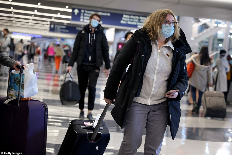 Millions of Americans are set to travel ahead of Christmas and New Year's despite pleas from public health experts to stay at home (Chicago)
