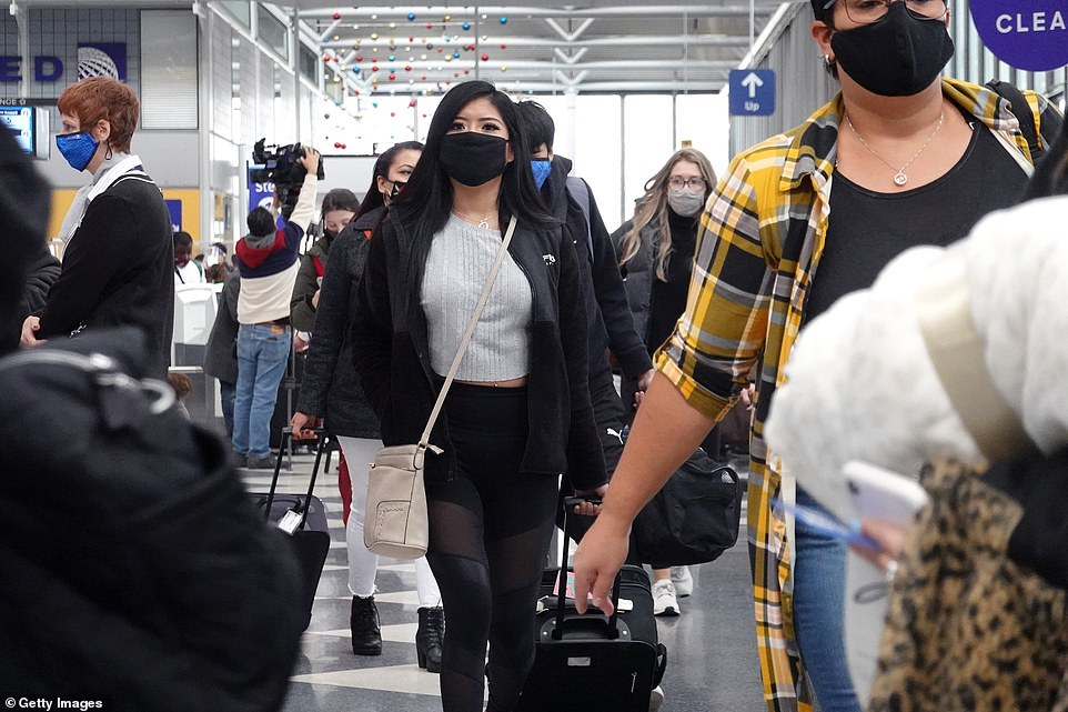 Travelers pass through O'Hare International Airport on December 23, 2020, as the Christmas holidays drew close