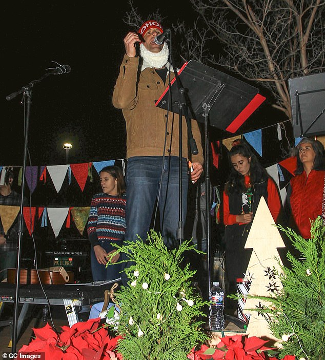 Parking lot:The Christmas carol protest was held outdoors in a parking lot of The Oaks mall