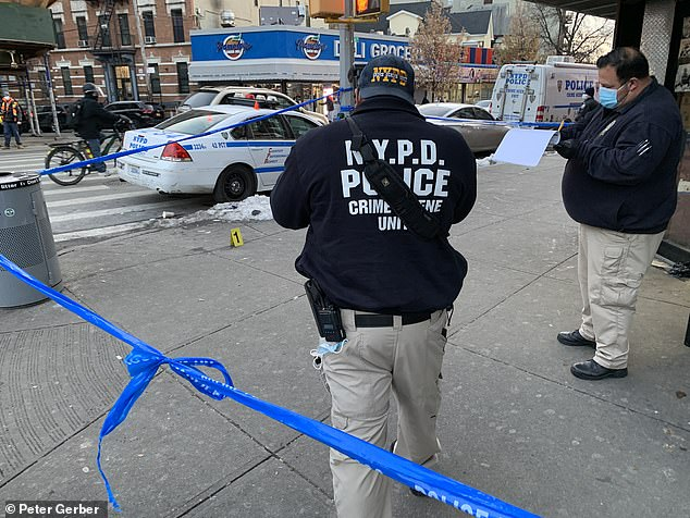 Pictured: Police taking pictures of the crime scene outside of King Deli and Grocery