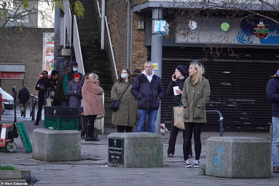 Most people would have needed to pre-order their turkeys from the butchers in time for Christmas. Pictured is a queue outside a butchers in Bermondsey
