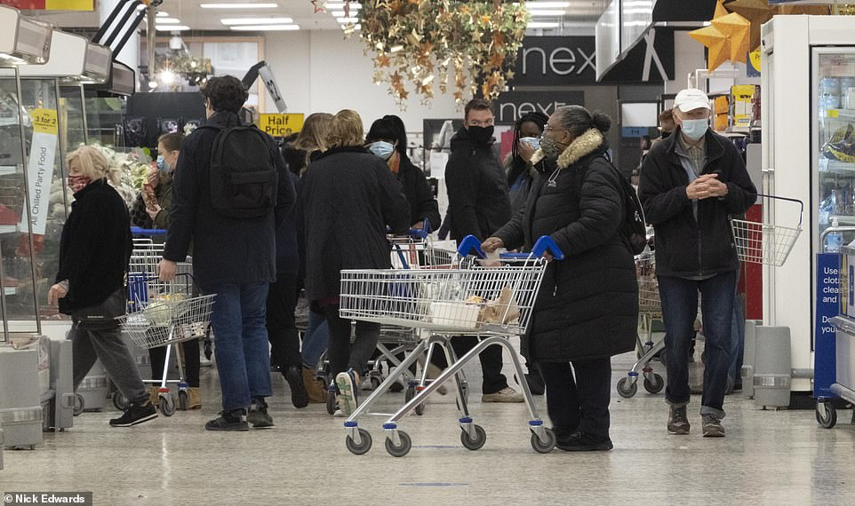 Shoppers at a Tesco Extra in south-east London this morning. Tesco has limited purchases of toilet roll, eggs, flour, pasta, soap and handwash