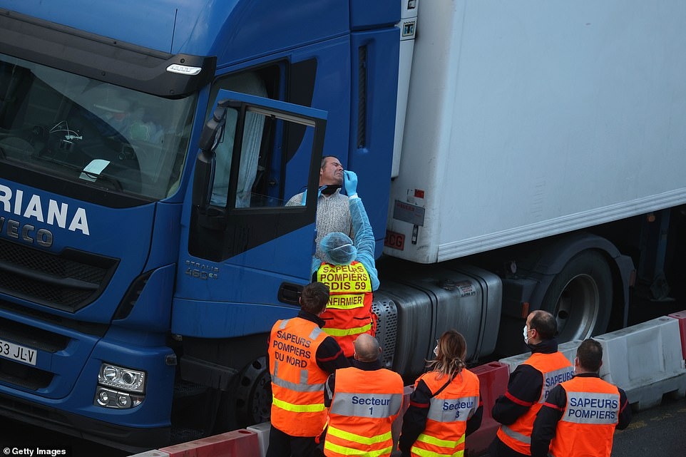 A group of 24 firefighters from the continent have joined the testing effort, personally administering the swabs to lorry drivers after President Emmanuel Macron demanded truckers be swabbed before being allowed to cross the Channel