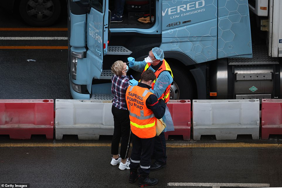 Unlike the the French firefighters, the British testing teams are passing over the swabs for lorry drivers to self-administer - a method which is considered less effective