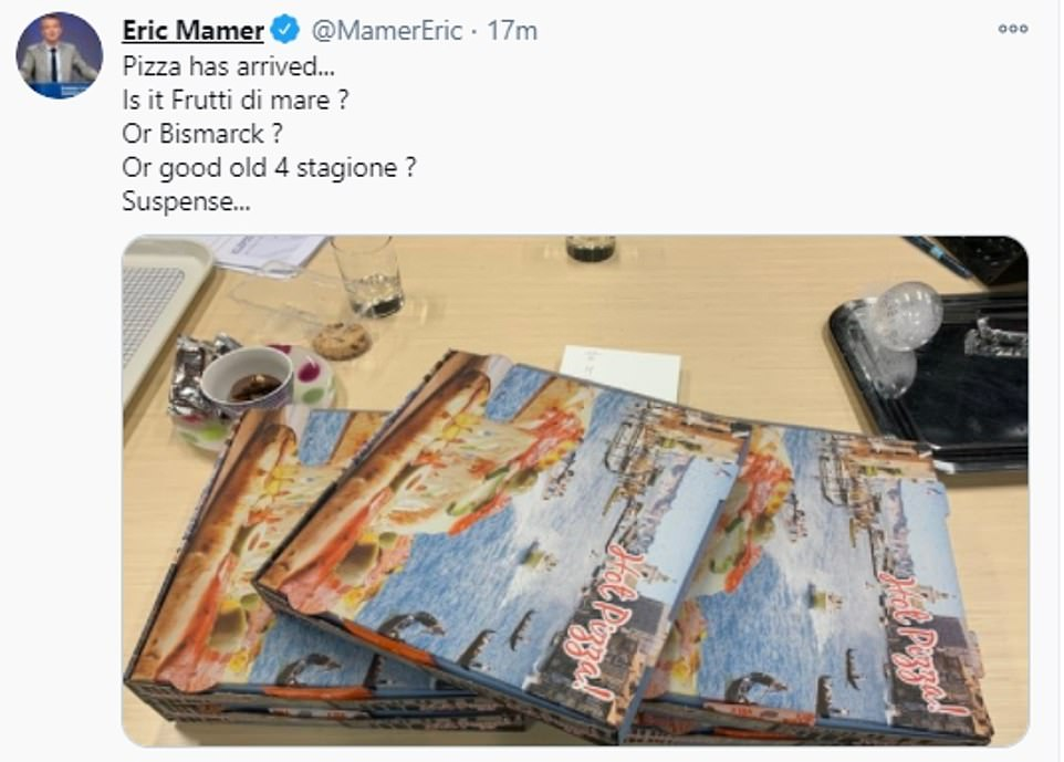 Ms von der Leyen's spokesman posted a picture of his pizza dinner on Twitter, joking about the 'suspense' over whether it might be topped with seafood