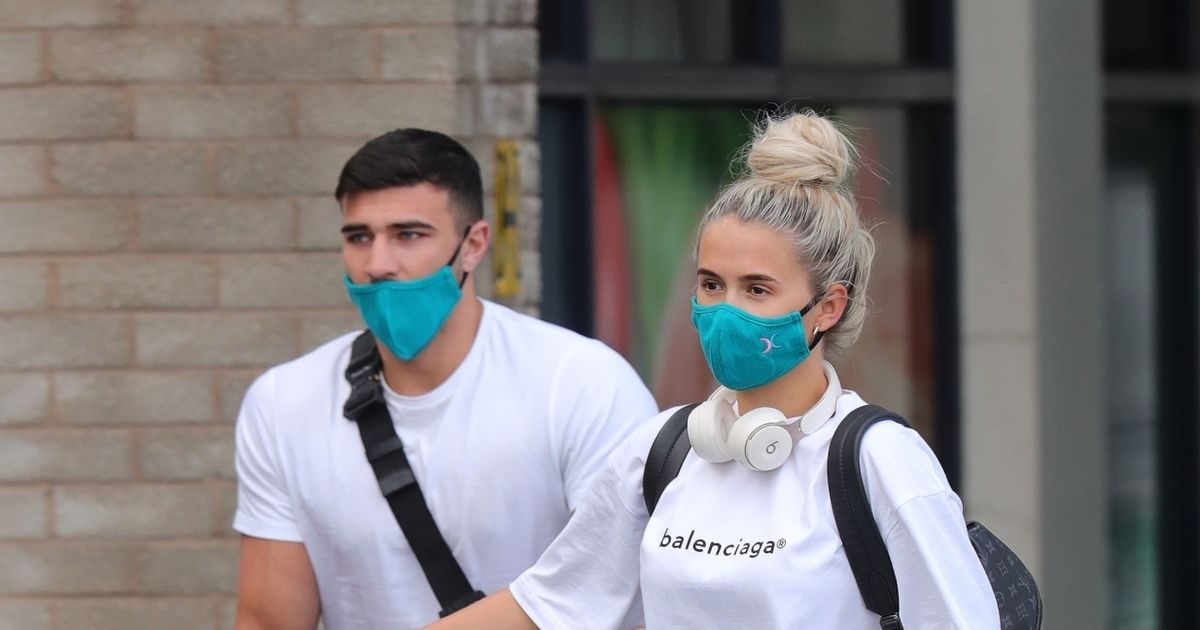 Molly-Mae Hague and Tommy Fury land in the UK after backlash over Maldives trip