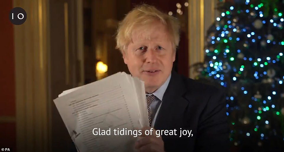 Following his announcement earlier today, Boris Johnson took to Twitter to urge people to comply with coronavirus rules over Christmas, before waving a copy of the Brexit deal before the camera, promising it was a 'feast' for Britain