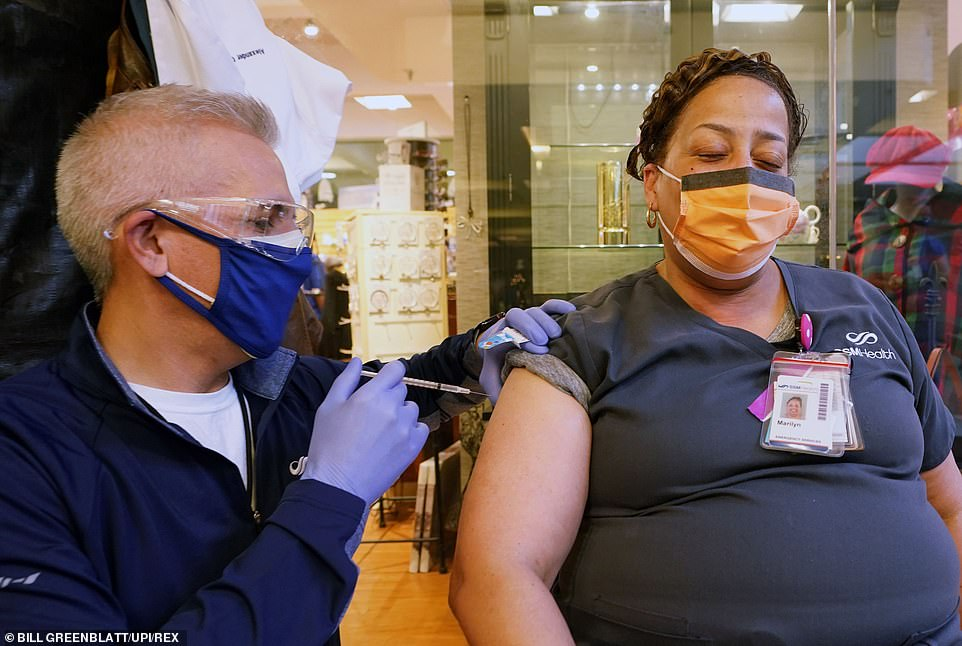 The IHME model has warned that no vaccine rollout will result in tens of thousands more deaths. Pictured, a vaccine is administered to a nurse atSt. Mary's Hospital in Richmond Heights, Missouri on Thursday
