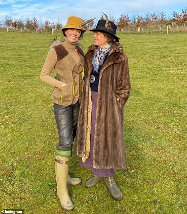 Lady Eliza shared an adorable photograph with her mother, Emma, the Duchess of Rutland, 57, who is chief executive of the estate, in the grounds of the castle