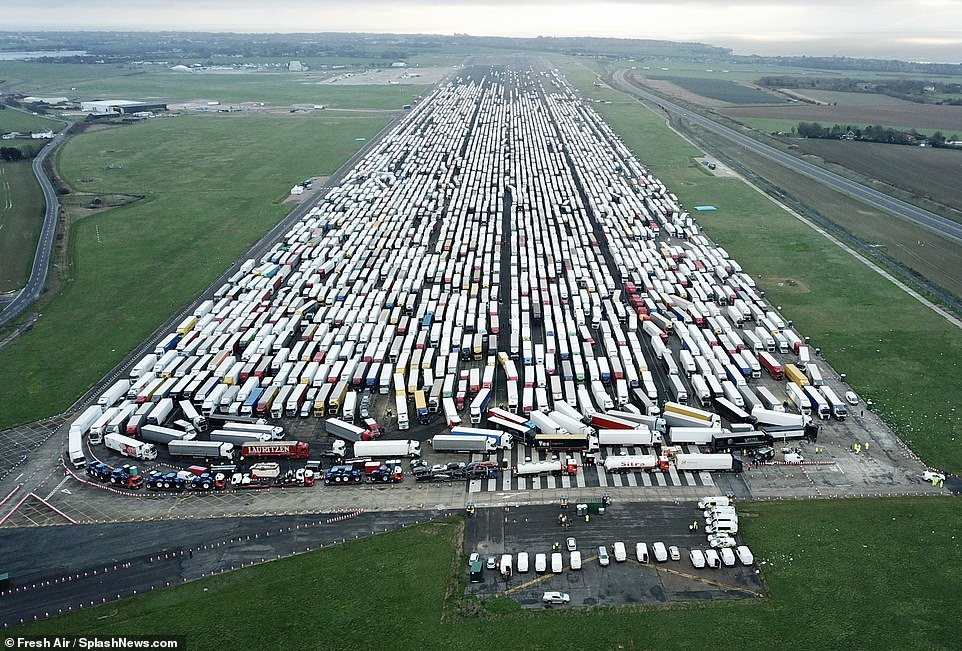 Some drivers have already spent nearly a week stranded at Manston (pictured on Christmas Day) due to the diplomatic impasse after the French closed their borders