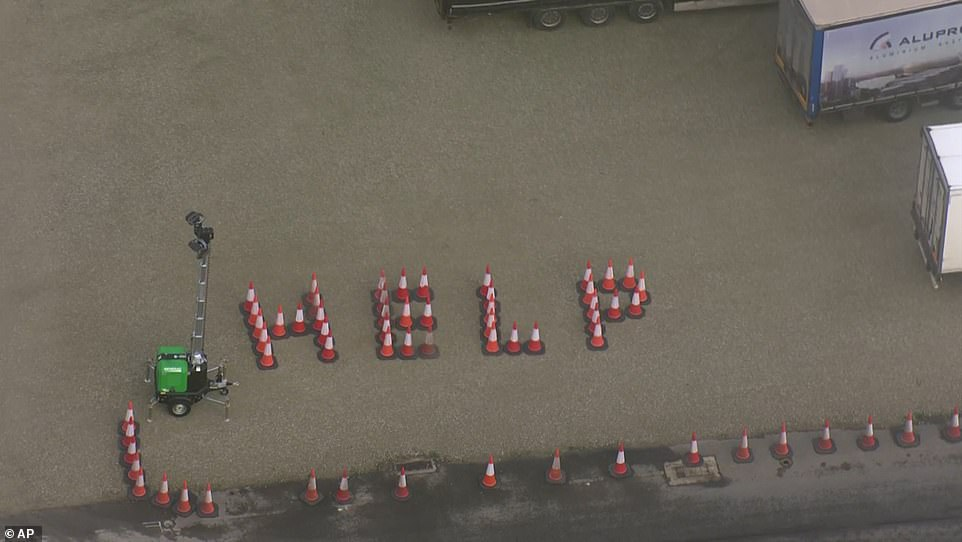 Drivers still stranded in Dover spelt out 'help' using traffic cones after days of waiting in Kent