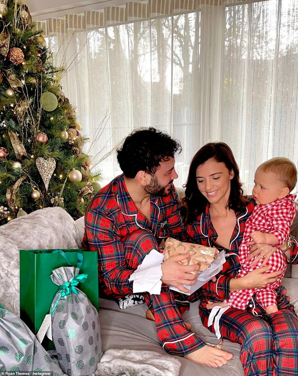 Family snap: Ryan Thomas and his fiancee Lucy Mecklenburgh were spending their first Christmas with their son Roman, nine months, as they sported matching pyjamas and cuddled up to their little boy