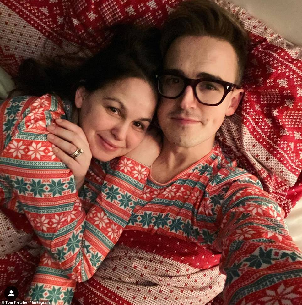 Cute! I'm A Celebrity winner Giovanni Fletcher and her husband Tom appeared as loved-up as ever as they posted a picture together in bed wearing a pair of matching festive pyjamas each
