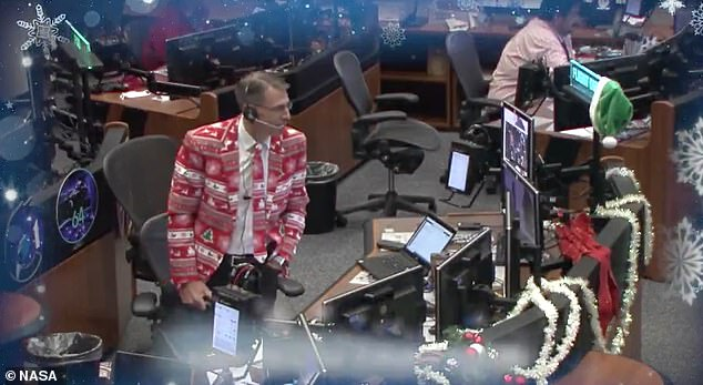 NASA flight director Zebulon Scoville in a festive red-and-green holiday blazer with the Mission Control team at the Johnson Space Center in Houston