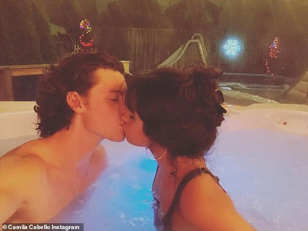 Thankful: Camila Cabello captured a photo of herself planting a kiss on her beau Shawn Mendes' lips as they relaxed in a jacuzzi surrounded by Christmas lights