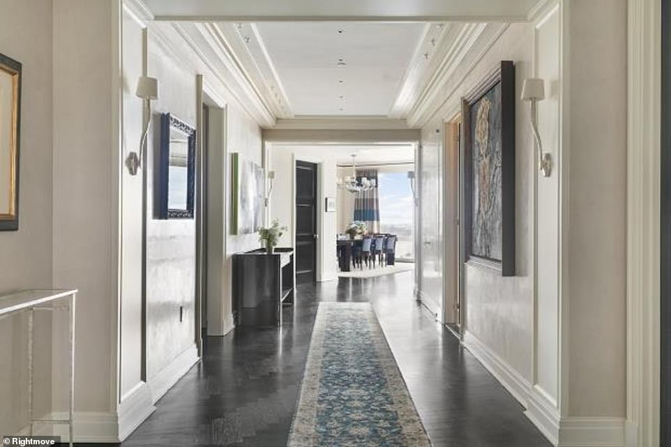 A large entryway leads into the Great Room which overlooks Central Park. It has a family library, an informal family dining area, a formal dining room, and a large formal living room