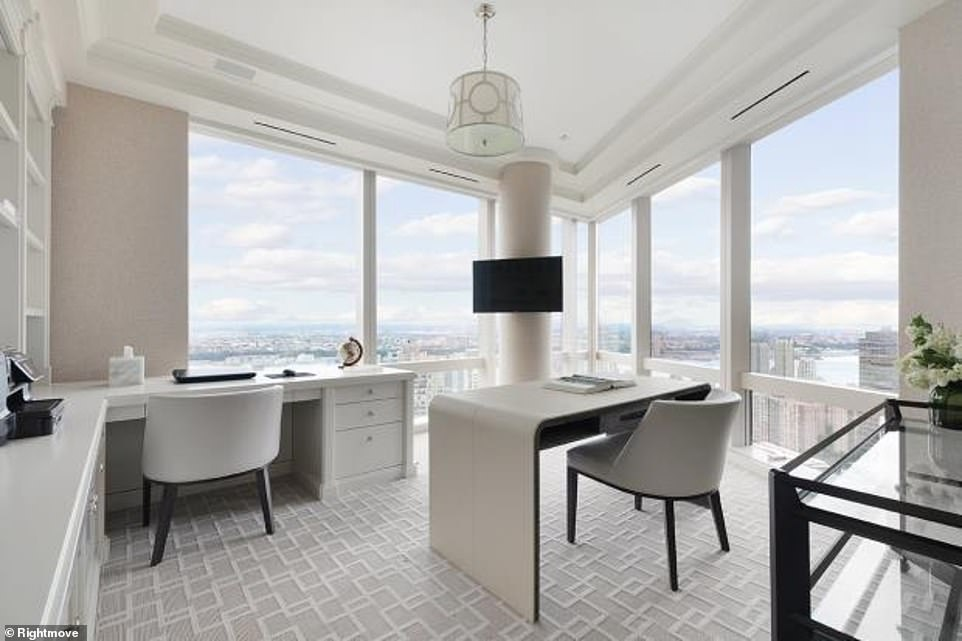 The property's study space is bright, airy and clean. The floor-to-ceiling windows give ample amounts of natural light