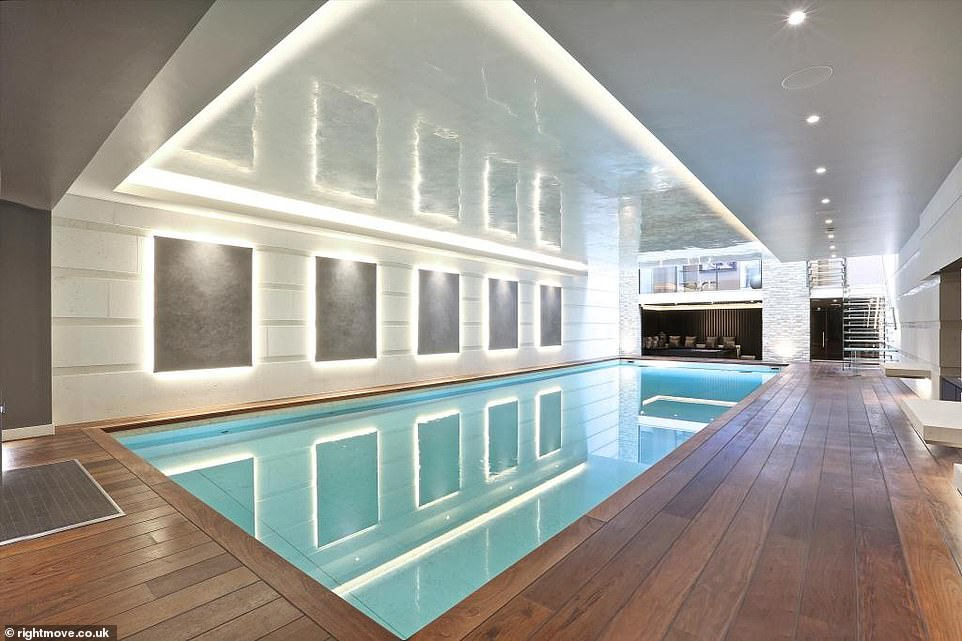 This £54.5million 12-bedroom property, fitted with an indoor swimming pool (pictured), would be perfect for one of London's 55 billionaires - who have a total net worth of £167.5billion