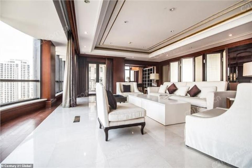 Shanghai is home to 45 of the 2,153 men and women on the Forbes World's Billionaires List. This £9.3million property (its living room, pictured) would place one lucky buyer in an ideal city location