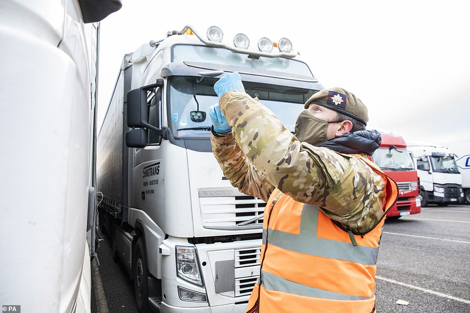 Despite mass efforts to administer coronavirus tests to lorry drivers stranded in Kent, some done by army personnel on Friday (pictured) around 3,000 are still left stranded