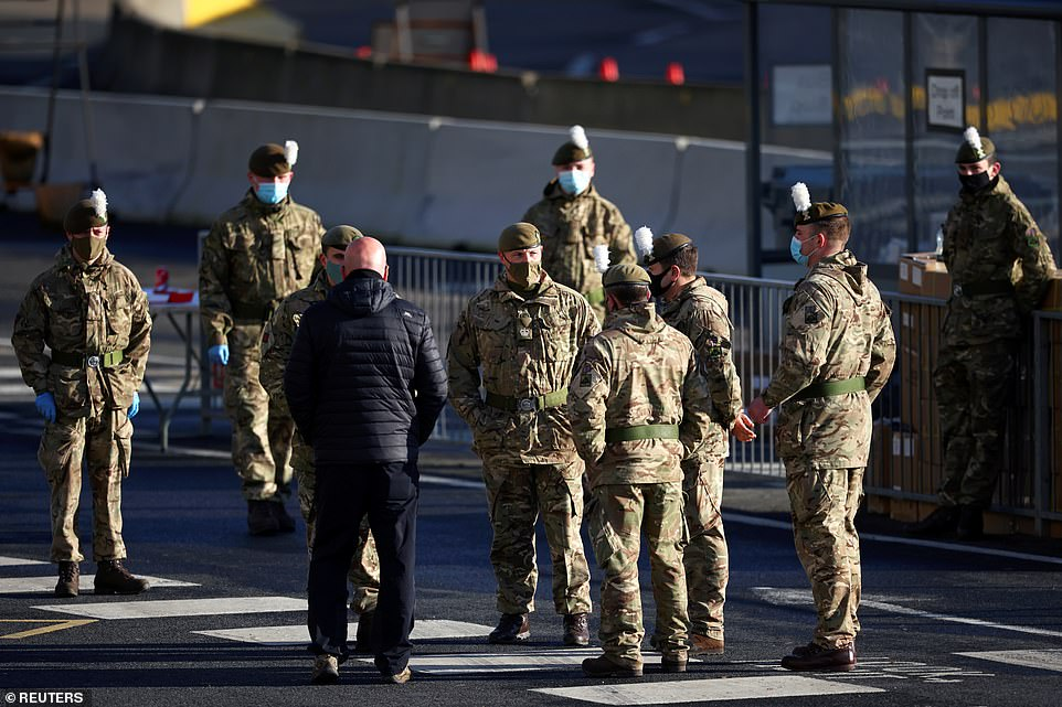 Soldiers stand at the entrance of the Port of Dover, amid the coronavirus outbreak in Britain on Christmas Day