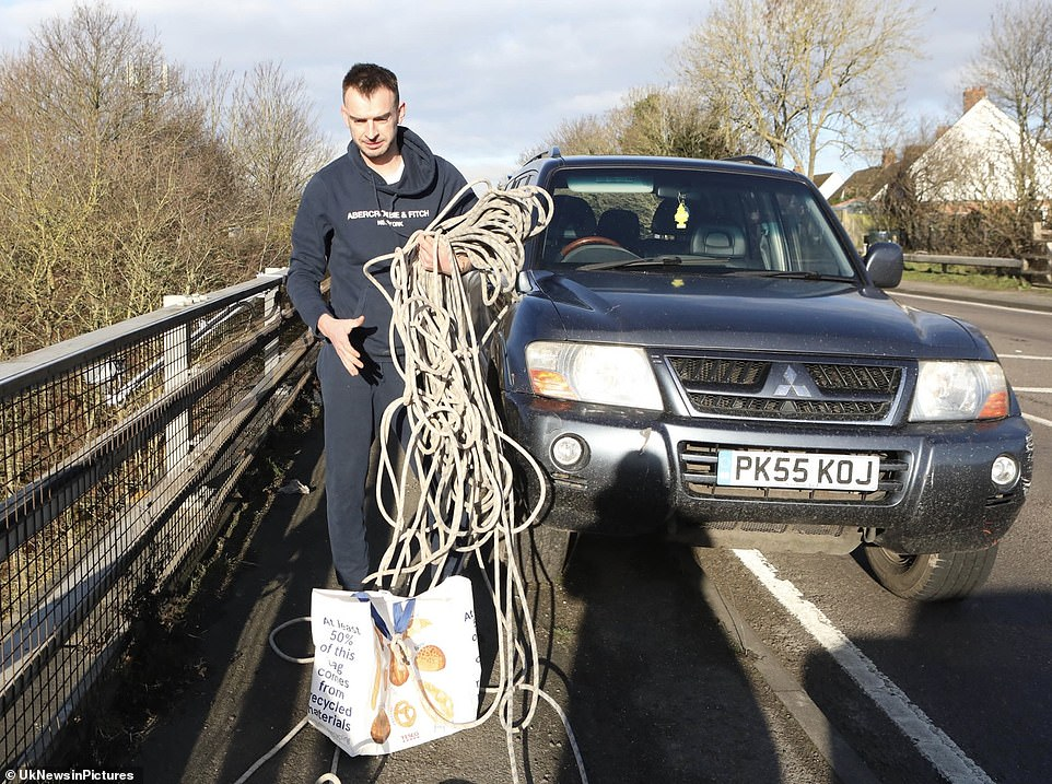 Members of the public deliver food to stuck lorry drivers on the M20 in Kent using rope from motorway bridges
