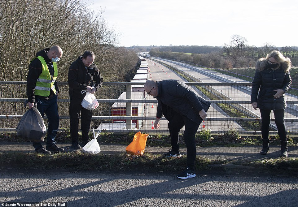Kind locals Allan and Elizabeth Wilson from Lenham Forstal in Kent bring food to stranded lorry drivers on the M20 in Kent. The packages contained a Christmas lunch of turkey sandwiches and drinks