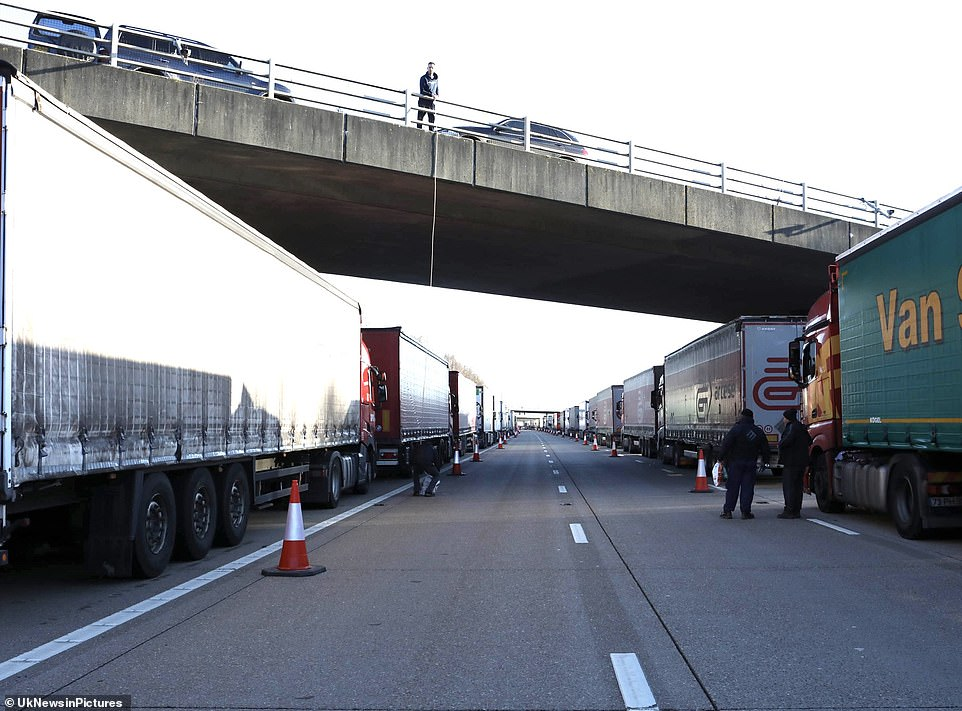 Pictured: Food is delivered from motorway bridges to thousands of lorry drivers stuck trying to access the Port of Dover