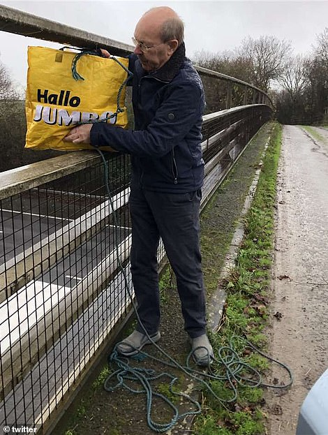Kent villagers are helping feed stranded truck drivers lined up along the motorway by lowering bags of food to them from bridges