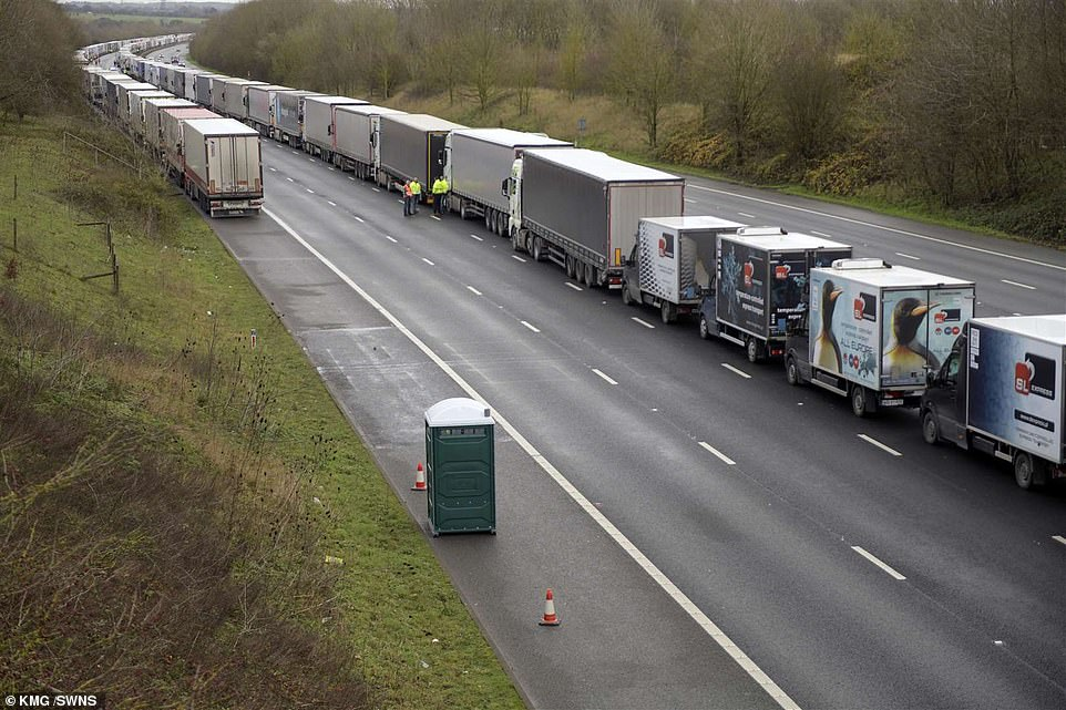 Villagers lower food from M20 bridges near Ashford to truckers stuck in Operation Stack as Domino's deliver pizza