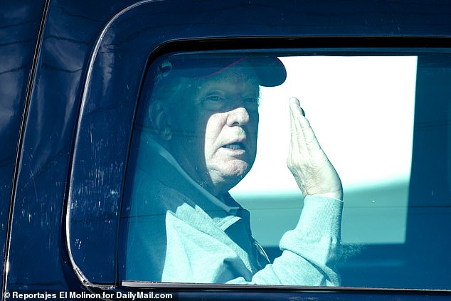 Trump is captured waving to supporters on his return trip to Mar-a-Lago on Christmas Day
