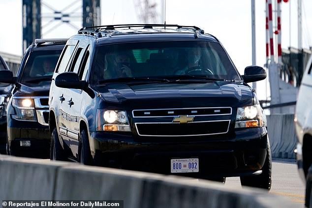 Trump's motorcade is photographed as it leaves Mar-a-Lago in Palm Beach, Florida for his nearby West Palm Beach golf club. The president also spent part of Christmas Eve on the course