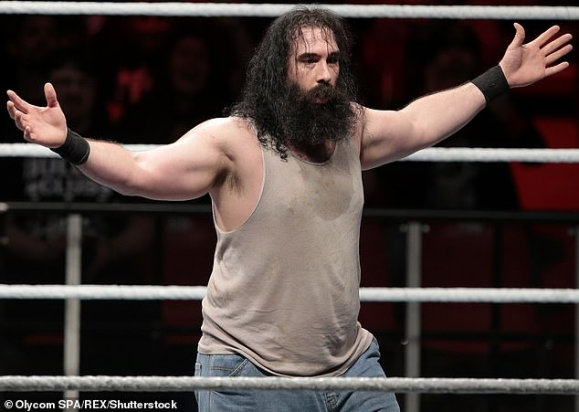 In the ring: Jonathan was previously known by the persona Luke Harper, when he wrestled at WWE from 2012 to 2019 (pictured in November, 2014)