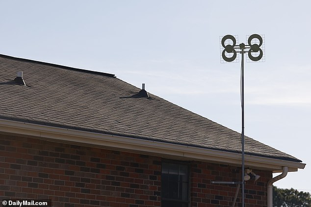 Warner was often spotted fiddling in his yard with odd antennas, including this one behind his house, which appears to be a ClearStream HD digital television antenna