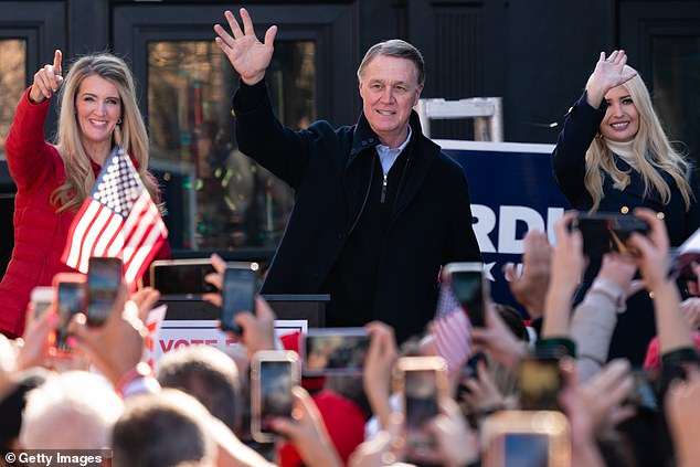 Luntz said that it is possible incumbent Senators Kelly Loeffler and David Perdue could lose their January 5 runoff elections because Trump's calling into question the integrity of the vote could depress GOP turnout. Loeffler (left) and Perdue (center) are seen above alongside the president's daughter, Ivanka Trump (right), at a rally in Milton, Georgia, on Monday