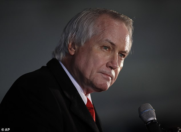 Attorney Lin Wood, pictured, has suggested Georgia's GOP senators Kelly Loeffler and David Perdue as well as Governor Brian Kemp should be arrested while also urging Republicans not to vote in the state's run-off