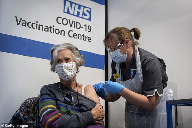Pictured: Doreen Brown, 85, receives the first of two Pfizer Covid-19 vaccinations at Guy's Hospital, London, on December 8