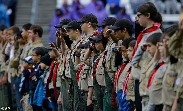 The Boy Scouts pictured above saluting the flag in September 2013 in Seattle