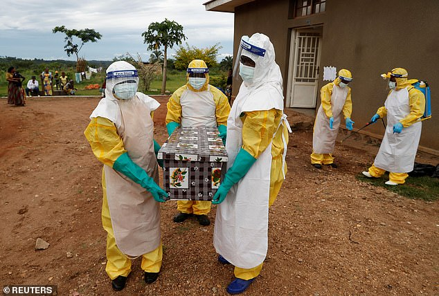 Unit 68240 of the country's FSB spy agency is believed to be researching both Ebola and the even-more deadly Marburg virus. Pictured:Healthcare workers carrying a coffin with a baby, suspected of dying from Ebola, in the Democratic Republic of Congo in 2018