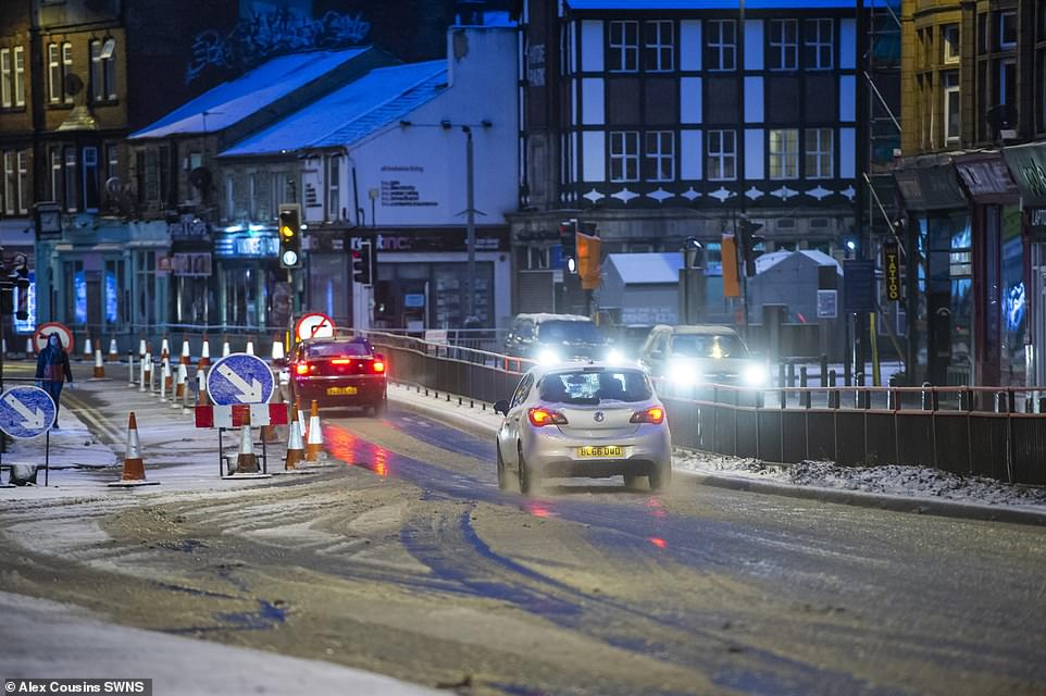 Traffic moves along icy roads in Leeds this morning after parts of West Yorkshire were hit by snow