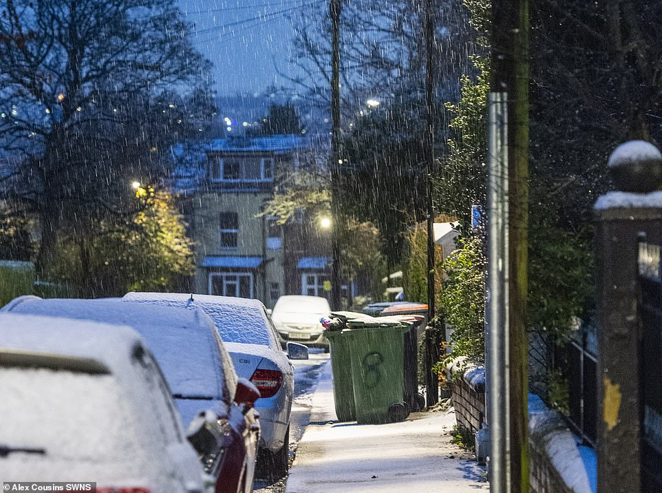 Snow falls on a street in Leeds this morning as parts of the country are set for further flurries in the next few days