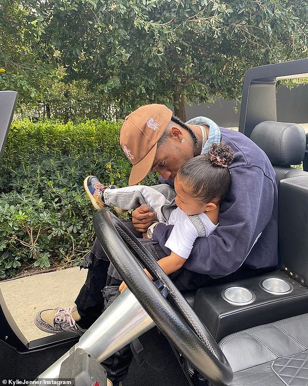 Tops:The fourth most liked image was from Kylie's Instagram page, but did not show her face. It was of ex beau Travis Scott holding their child Stormi, and it went on to garner 15,993,585 likes. 'DADA happy birthday to daddy of the year! i'm slowly but surely starting to accept the fact that storm is a daddy's girl. The image was shared on April 30, 2020