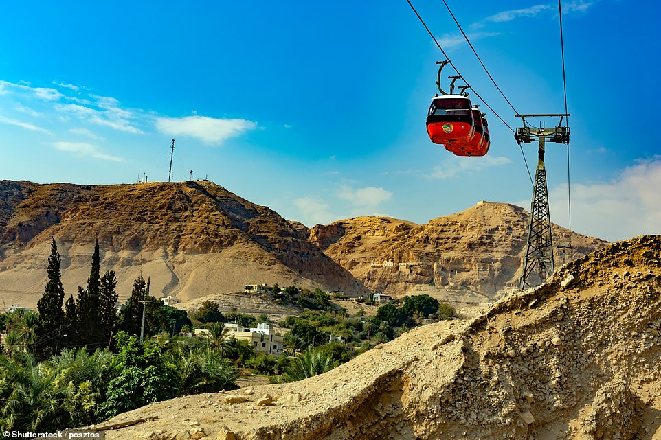 A modern cable car transports visitors to the entrance of the monastery on the Mount of Temptation