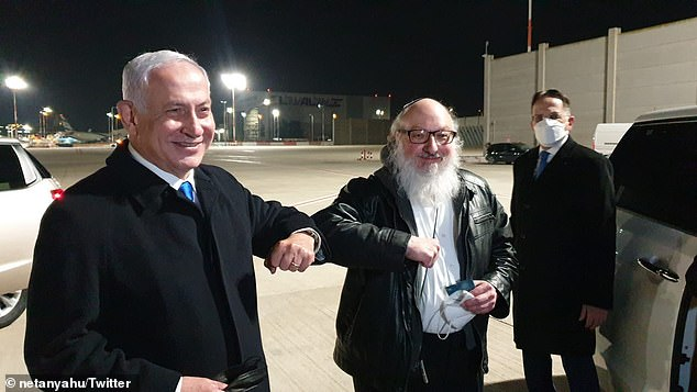 Netanyahu tweeted a photograph of himself giving Pollard an 'elbow bump' on arrival