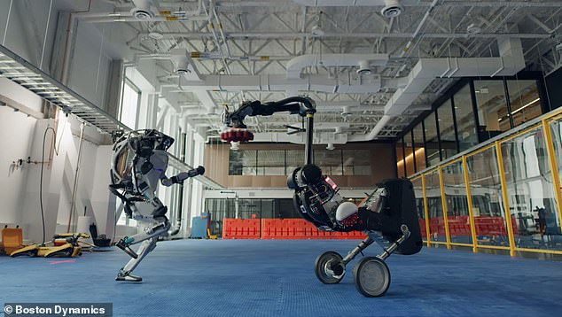 'Our whole crew got together to celebrate the start of what we hope will be a happier year: Happy New Year from all of us at Boston Dynamics,' reads the YouTube video caption