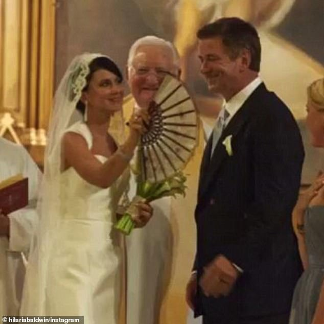 Hillary Thomas-Hayward officially became Hilaria Baldwin when she wed husband Alec, with tributes to her claimed Spanish roots, with the bride wearing a mantilla-inspired veil, cooling herself with a flamenco hand fan and nuptial readings in both English and Spanish